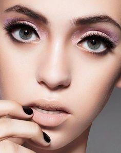 Heavy Eye Make-up and subtle everywhere else. Doll eyes.