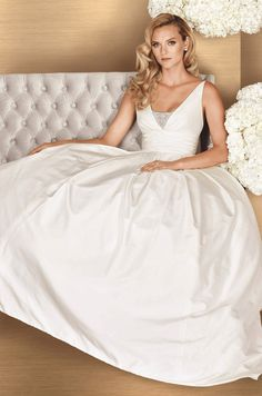 View Silk Dupioni Wedding Dress - Style 4661 from Paloma Blanca. Draped V-neckline with beaded insert. Full pleated skirt. Side pockets. Cathedral Train