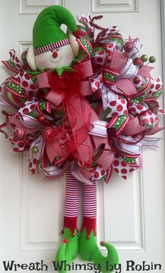 Deco Mesh Holiday Wreath with Elf Head and Legs. This whimsical holiday wreath is bright, playful and so much fun! The wreath is constructed