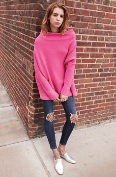 Ripped knees put a rough-and-tumble slant on these skinny jeans cut with a high waist.