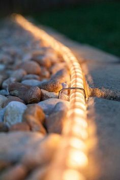 Use rope lighting to line your garden crafts and diy pinterest illuminate a walkway with these rope lights this and more summer backyard ideas on frugal aloadofball Image collections