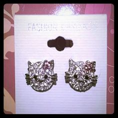 *New price* NEW Hello Kitty earrings Silver with adorable pink bow and rhinestone earrings for pierced ears. Jewelry Earrings