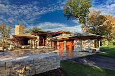 Residential Landscape Design Over One Acre | 1st - JEFFREY WHITE INC. & ASSOCIATES  Every detail of this landscape was designed as a visual symphony and study in stonework. Every stone element, while contrastingly different in shape, texture, color, and size, melodiously complements the others. As composed, all blend harmoniously to provide a unified visual concert-in-stone that is ever-changing as one moves about the estate.