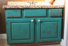 refinish oak cabinets... i wish i was this brave! but really, how awesome would it be to have distressed bathroom cabinets. so much more fun!!