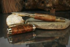 The Harrison Series Rollerball Pen. A beautiful Burled Tasmanian Myrtle finish and gold trim make this a gorgeous pen! $80