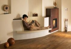a reading spot on the heater. Living Area, Living Room, Home Fireplace, Fireplaces, Rocket Stoves, Earth Homes, Small Spaces, Home Furniture, Foyer