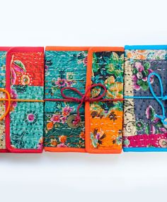 This journal has a colorful quilted cover enhanced with striking embroidery. #FairTuesday