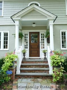 100 Year Old House Front Porch - Love the steps with brick on the risers and slate/stone on the steps. Wood door with white trim. Love this door, maybe for the garage or side front porch doors? House Front Porch, Front Stoop, Front Entry, Portico Entry, Front Doors, Colonial Front Door, Front Door Overhang, Brick Porch, Front Door Steps