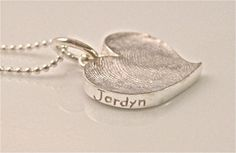 I love this fingerprint necklace from Stacey Smith Jewelry...I would love to get a mother's necklace done with each of my children's prints on it.