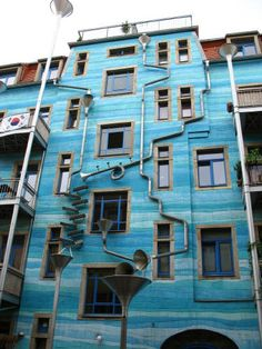 Rube Goldberg Rain Drainage System - Check out this crazy-cool drainage system on an apartment building in Dresden, Germany. 16 Cool Rube Goldberg Machine Ideas, http://hative.com/rube-goldberg-machine-ideas/,