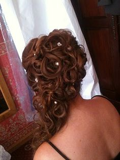 Amazing curled half up with jewelled pins . It's so beautiful, but i would have to have a professional do it.