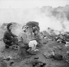 Recently liberated inmates at Bergen-Belsen burn the clothes of the dead to help limit the spread of disease.