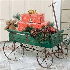 Christmas Front Door Wagon (the link takes you to Lillian Vernon, who says such a product doesn't exist. Christmas Front Doors, Christmas Town, Christmas Door Decorations, Country Christmas, Christmas Sleighs, Christmas Holidays, Christmas Crafts, Christmas Stuff, Sled Decor