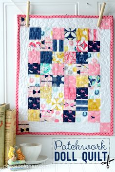 A free sewing pattern for a patchwork doll quilt on the polka dot chair blog. Simple quilt pattern made with Derby Style Fabric.