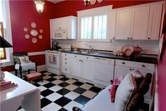 Love the black & white tile and red walls. Very dramatic!