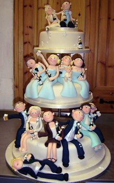 Three ivory satellite wedding cakes, decorated with caricatures of each and every person involved in the entire bridal party on each of the tiers, including mum and dad. And a drunk groomsmen lying on the floor holding a bottle of champagne