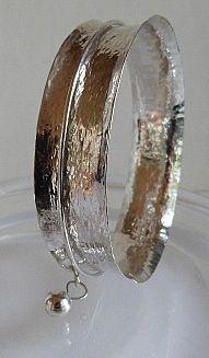 anticlastic beaten silver bangle