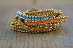 Teal Coloured Woven Friendship Bracelet with Gold Beads. $23,00, via Etsy.