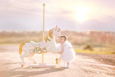 www.nikkalaannephotography.com  girl carousel horse photo session idea inspiration