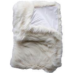 Add textured appeal to your living room sofa or arm chair with this luxe faux fox fur throw in cream.Product: Throw