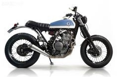 Sometimes it's the unlikeliest motorcycles that become popular with custom builders. The Yamaha Virago is one, and the Honda Dominator another. This is Cafe Racer Dream's take on Honda's venerable NX650 dual-sport thumper: they've stripped off the clunky plastics and added a strong dash of Spanish style.