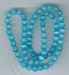 6mm Sky Blue Cats Eye Beads by RockNBeads on Etsy, $3.00