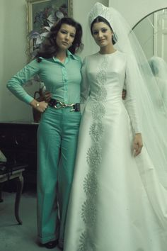 "Carmen ""Carmina"" Ordoñez and sister, Belen in the day of her wedding with Francisco ""Paquirri"" Rivera. Spain, Note: Carmen was related to the Duchess of Alba through her son, Francisco Rivera,. 1970s Wedding Dress, Modest Wedding Gowns, Custom Wedding Dress, Wedding Dress Sleeves, Bridal Gowns, Celebrity Wedding Photos, Vintage Wedding Photos, Vintage Bridal, Celebrity Weddings"