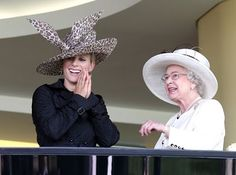 Stylishly conservative, Zara Anne Phillps, works an animal print hat with a fabulous trench coat for the races.