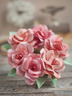 DIY Mini Paper Rose Wreath in blush pink with tutorial. Perfect for wedding or bridal shower decor!