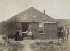 Photograph:Pioneers on the prairies built houses out of sod if they could not find trees to use for wood.