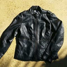 """Black Faux Leather Jacket Black Faux Leather Zip Up Jacket/Coat. Brand: New Mix U.S.A. Light weight fashion jacket. Shell: 100% Polyurethane. Backing: 100% Viscose. Lining: 100% Polyester. Dry Clean Only. All zippers work. No inside pocket but 2 useable front pockets. When zipped up, laying flat: from shoulder to waist is 23.5"""" long, across chest from armpit to armpit is 19"""". Sleeve length"""" 25"""" long. Tagged size is 1XL. I'm assuming the size is from China. No rips, tears, flaws, or defects…"""