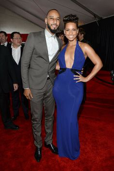 Swizz Beatz and wife Alicia Keys attend the show, with Alicia stealing the spotlight in this plunging royal blue gown.