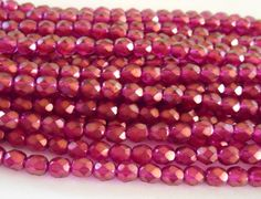 Lot of 25 6mm Halo Madder Rose Czech glass beads, firepolished, faceted round beads with a transparent gold finish, C5525