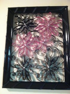 Pink and black flower toilet paper roll wall decor.