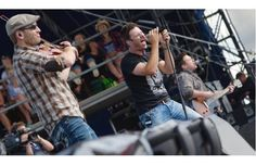 From left, David Pichette, Brad Mates and Danick Dupelle with Emerson Drive perform on the mainstage at the Big Valley Jamboree in Camrose.