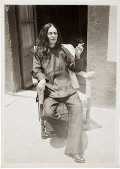 """Frida Kahlo.. Frida, 1932, by Guillermo Kahlo, framed in the show as an image in """"Frida at four stages of her life."""" This photo was taken seven years after a devastating crash that would partly define her life. The bus in which she was riding collided with a trolley car, breaking her spinal column, collarbone, ribs and pelvis, putting her in a full body cast for three months. She began to paint shortly after the 1925 accident to fill her time."""