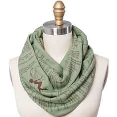 Join Peter Pan and Wendy Darling on their wondrous adventures in Neverland with this infinity scarf, featuring text from J. M. Barries classic novel.  This Storiarts Book Scarf is created from green American-made, 100% cotton jersey knit, about 63 in circumference and 12 wide. Fabric has been doubled over and sewn along the edge and at the center to create a thick, chunky, and moldable page. The text is printed in brown ink.  Additional FAQ: ✦ Please take a moment to read our shipping…