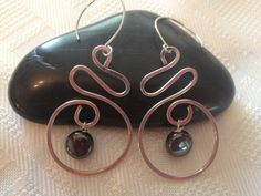 Hey, I found this really awesome Etsy listing by Hanandesigns at http://www.etsy.com/listing/157900287/swirled-circle-hematite-drop-earrings