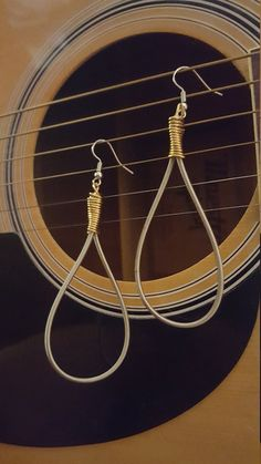 Guitar String Jewelry : Bass Guitar Strings : Upcycled Jewelry: Handmade:  https://www.etsy.com/listing/505480459/the-da-capo