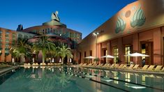 Let the refreshing water at the swimming pool at Walt Disney World Swan Hotel relax and pamper you.