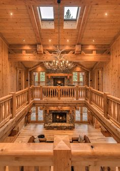 Gorgeous finishes | 2 fireplaces | amazing chandelier & skylights. Wow. #logcabins #chandelier #antlers