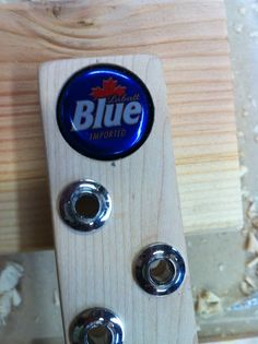 Home made guitar powered by a 12 megatron beer cap. Some Labatt's Blue and get ta playin. A custom beer cap inlay