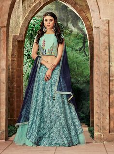 Stay stylish and trendy wearing this fashionable sea blue color silk and net fabric thread embroidered party wear lehenga. So its time to be your own style icon with this beautiful lehenga at the upcoming event. Lehenga Choli Wedding, Party Wear Lehenga, Indian Dresses, Indian Outfits, Indian Clothes, Womens Clothing Stores, Clothes For Women, Crop Top Designs, Blouse Designs