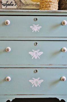 """Sophia's: Little Honeybee Dresser, Updated Booth Pictures, and House NewsI knew that since it's sort of a """"rustic"""" piece that I would be distressing it and making it """"cottagey"""".  After painting it out with Annie Sloan's Duck Egg (I've been on a Duck Egg kick lately), I decided the drawers needed a little something.."""
