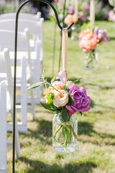 Hang canning jars filled with flowers along the aisles for an outdoor wedding ceremony. Outdoor Wedding Decorations, Ceremony Decorations, Flower Decorations, Outdoor Decor, Wedding Ceremony, Our Wedding, Dream Wedding, Reception, Hanging Mason Jars