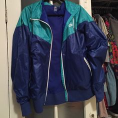Nike Two-Tone Windbreaker Nike Two-Tone Windbreaker; teal and blue windbreaker; sz XL but maybe XXL; never been worn; hoodie and drawstrings to tighten; no trades & no PP. Nike Tops Sweatshirts & Hoodies