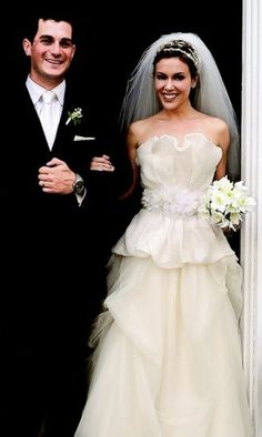 Alyssa Milano - Vera Wang wedding gown with ruffled top and beaded floral belt. Photo Larry Busacca/Getty Images