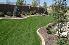 Backyard Ideas for Beauty, Fun, Family and Entertaining - This yard has a snake-like section of grass between manicured planting beds. Landscaping Retaining Walls, Landscaping Near Me, Landscaping Company, Outdoor Landscaping, Outdoor Gardens, Landscaping Ideas, Landscape Plans, Garden Landscape Design, Garden Edging