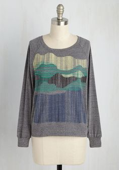 What's cookin', good 'lake'-in? In this heather grey pullover, you could be up to anything and it'd look inviting! Displaying raglan sleeves and an ivory, green, black, and blue graphic forming an abstract mountain range, this USA-made Supermaggie sweatshirt is the 'wildlife' of any party.