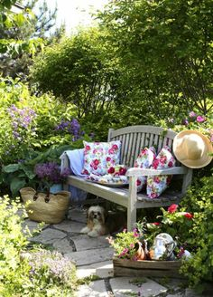 Rustic garden bench with floral pillows.